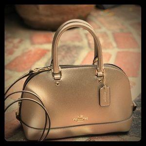 Rose gold Coach metallic handbag